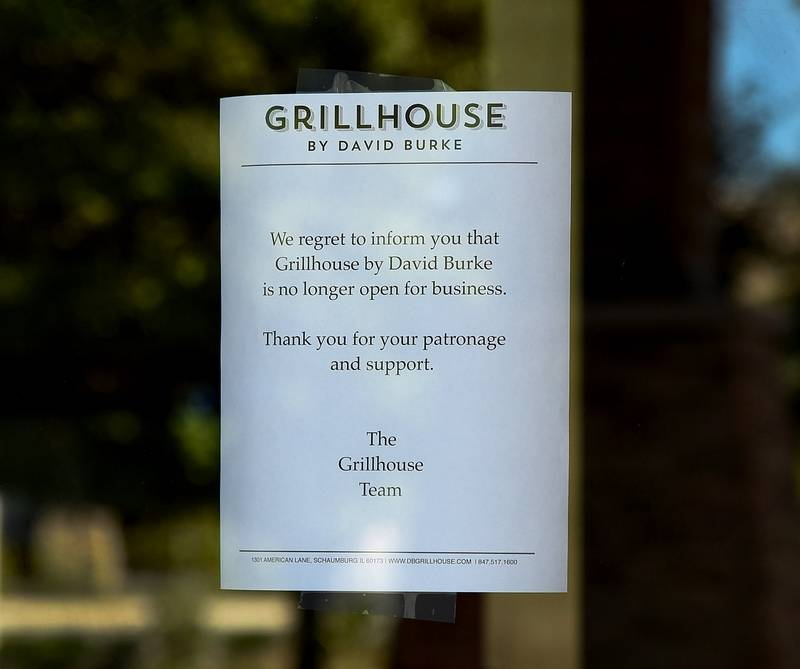 A notice on the front door of Grillhouse By David Burke in Schaumburg informs former patrons of the restaurant's closing and thanks them for their past business.