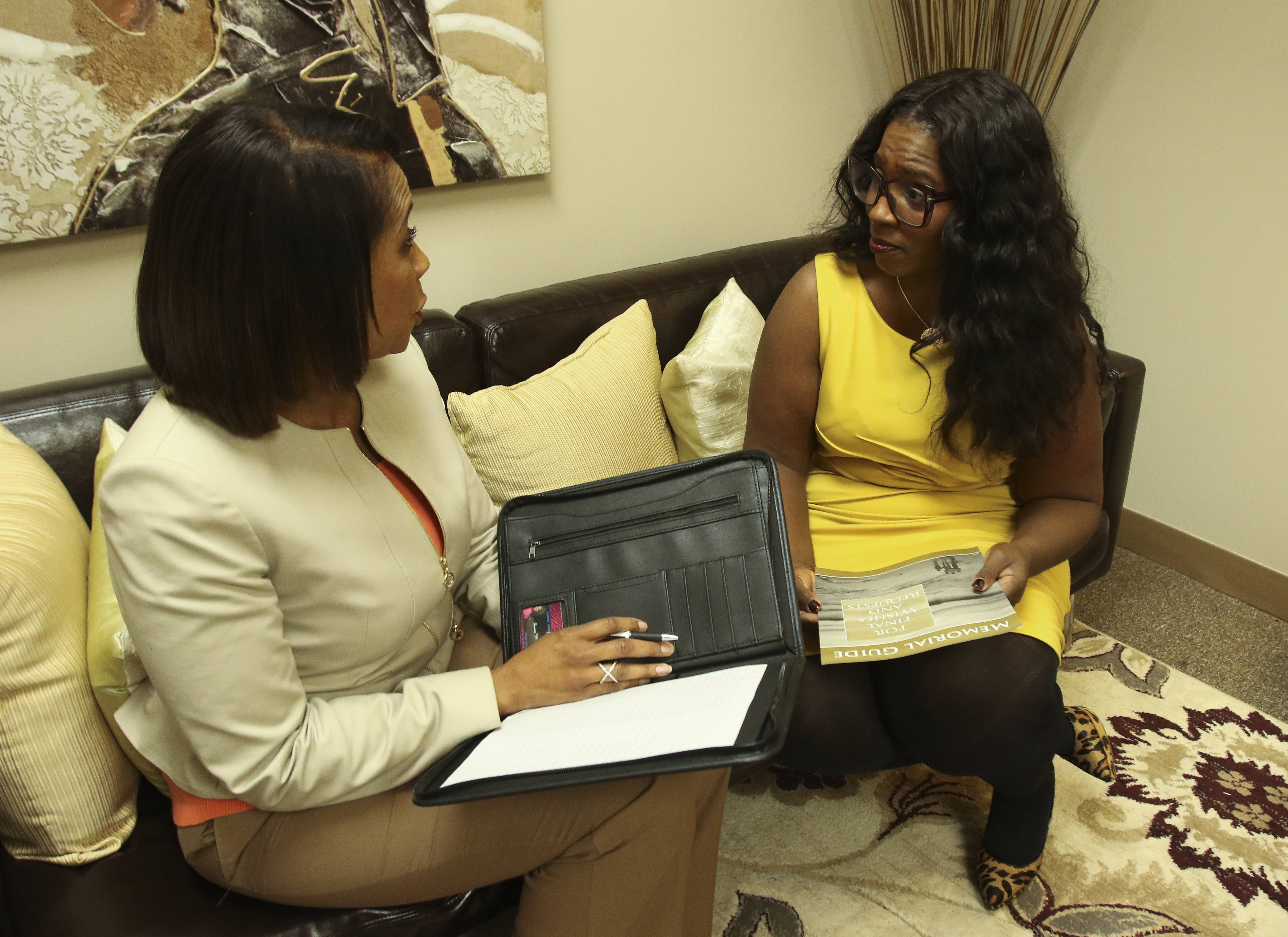 Shauna Weatherspoon with Weatherspoon & Associates in Naperville, chats with business associate Angela Caffey, division manager with Primeria.