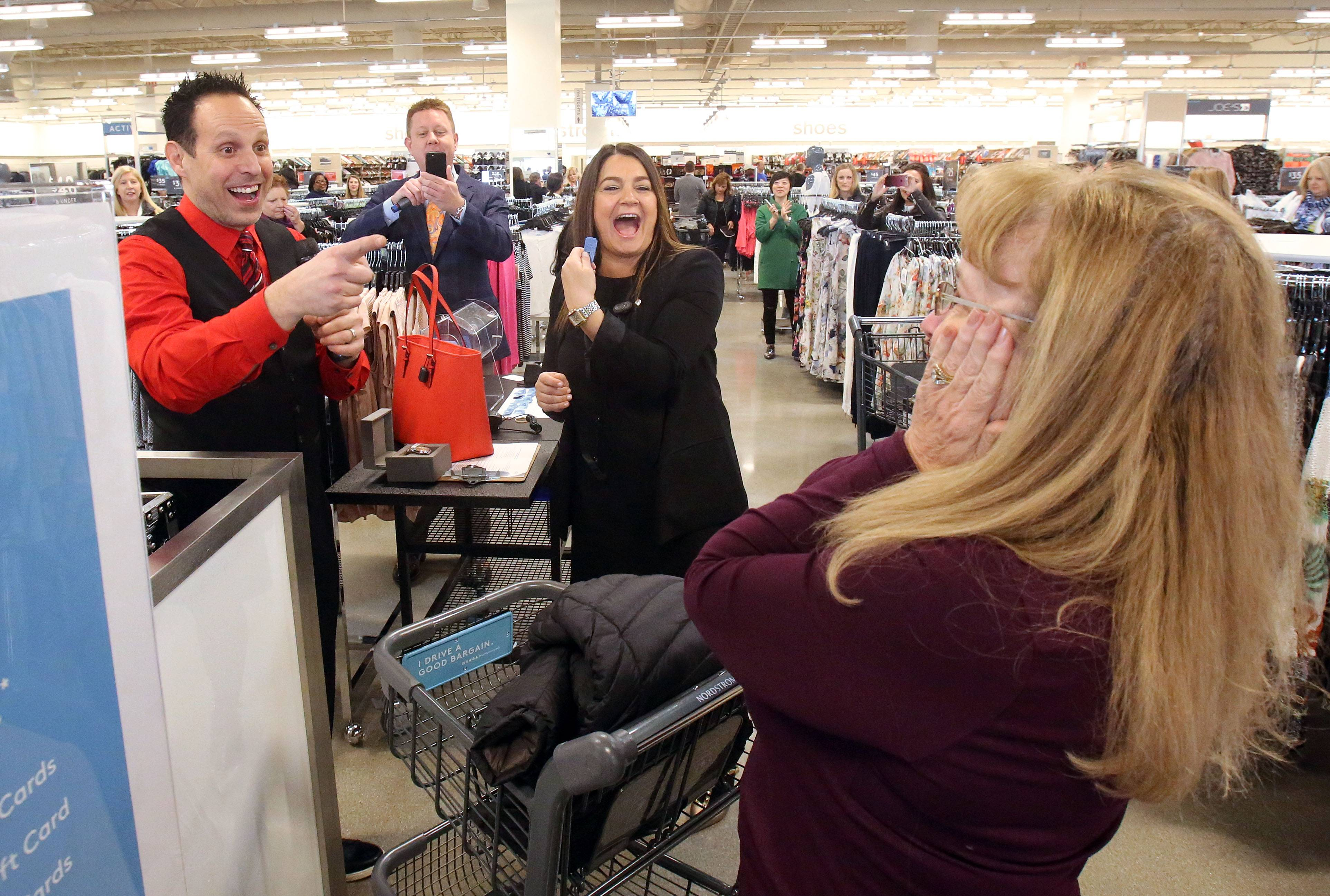 Kathy McKanna of Inverness, right, reacts after winning a $1,000 gift certificate at Nordstrom Rack during the store's grand opening at Kildeer Village Square Thursday morning.