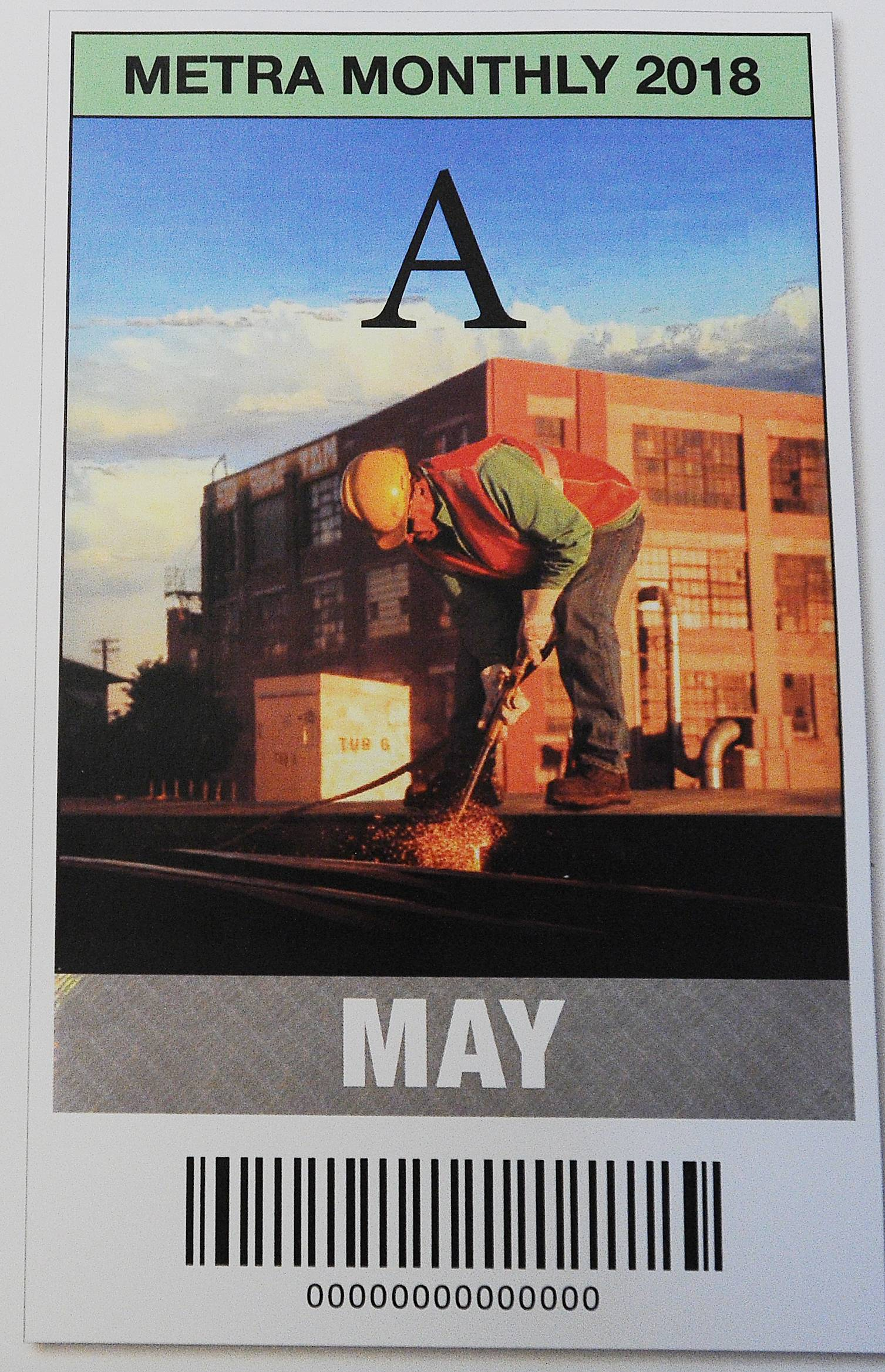 Metra graphic designer Ron Wojkovich uses photos shot by Metra employees to create a vintage look on monthly passes that evokes old railway posters such as this image of a worker welding.