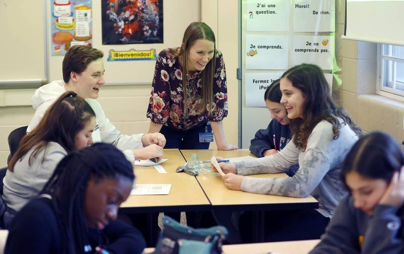 Teacher Courtney Croak at Stevenson High School in Lincolnshire helps some of her students with a project for a career and technical education course.